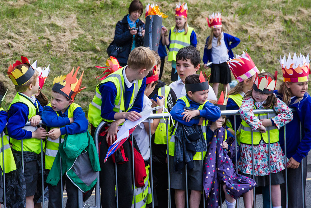 Local kids supporting the Olympic Torch Relay