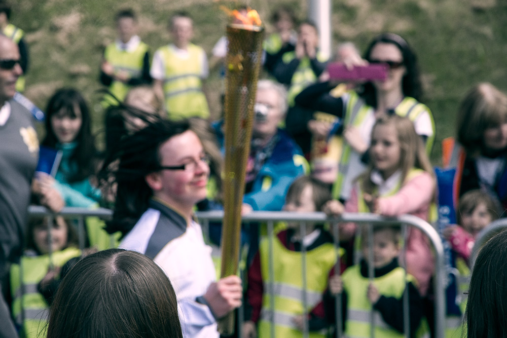 Blurry Olympic Torch runner