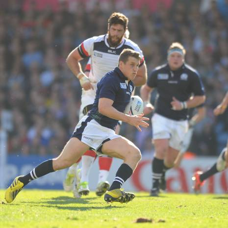 Mark Bennett - Scotland centre makes a break upfield.