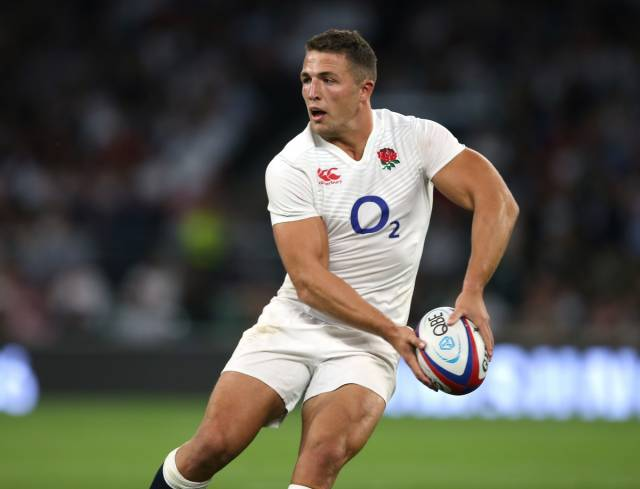 Sam Burgess of England with the ball.