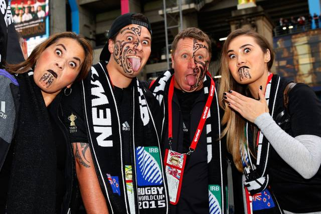 New Zealand fans pose for a photo. Rugby World Cup Semi Final, South Africa v New Zealand All Blacks, Twickenham Stadium, London, England. 24 October 2015. Copyright Photo: Paul Thomas / Fotosport
