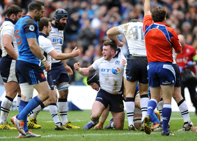 Stuart Hogg celebrates after his try.