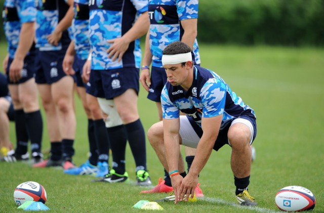 John Hardie - Scotland flanker stretches off at the start of the session. Scotland rugby tour of Japan, Tatsumi, Tokyo, Japan, Tuesday 14 June 2016. ***Please credit: David Gibson/Fotosport***