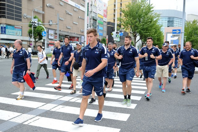 Huw Jones - Scotland centre (front) and the other players take in the sights during a short walk to the team bus outside Nagoya railway station. Scotland players arrive at Nagoya railway station as they make their way to the team coach ahead of Saturday's 1st test. Scotland rugby union tour, Nagoya, Japan, Wedesday 15 June 2016. ***Please credit: David Gibson/Fotosport***