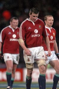 CAPTION: LIONS VICE CAPTAIN MARTIN CORRY IS FLANKED BY STEVE THOMSON (L) AND MATT DAWSON AS THEY LEAVE THE FIELD STUNNED AND DEJECTED AT THE FINAL SCORELINE OF 21-3 NEW ZEALAND V BRITISH & IRISH LIONS, 1ST TEST, JADE STADIUM, CHRISTCHURCH, NEW ZEALAND, SATURDAY 25TH JUNE 2005